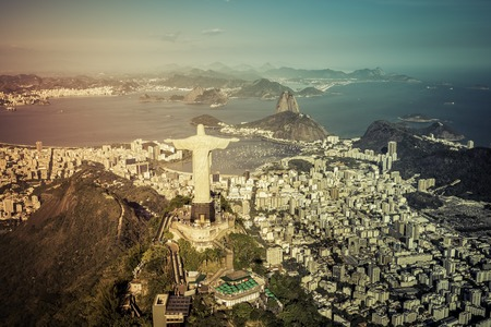 janeiro: Rio de Janeiro, Brazil : Aerial view of Christ and Botafogo Bay from high angle with light leak Stock Photo