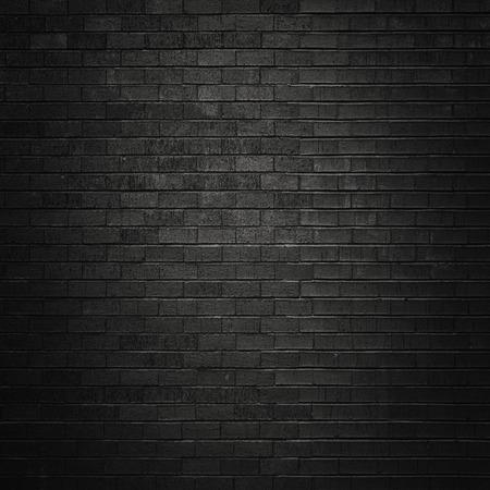 Zwarte bakstenen muur voor achtergrond