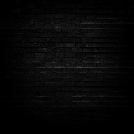 Dark Black brick wall with dim light for background Imagens