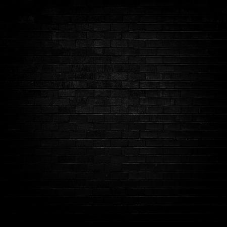 dim light: Dark Black brick wall with dim light for background Stock Photo