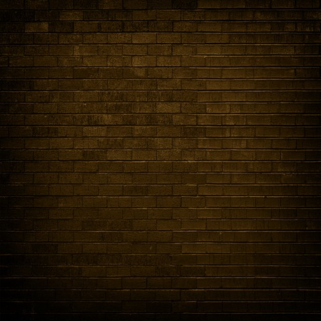 dim light: Brown brick wall with dim light for background