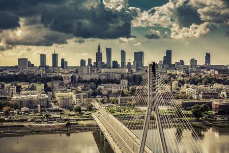 Warsaw skyline behind the bridge vintage view, Poland