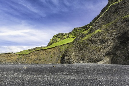 most popular: The black sand beach with typical Icelandic mountain landscapes Stock Photo
