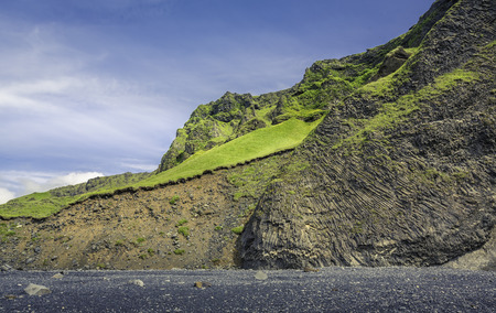 volcanism: The black sand beach with typical Icelandic mountain landscapes Stock Photo