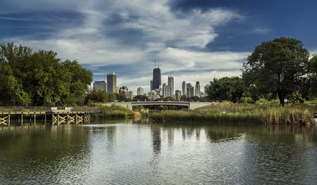 city park skyline: City park against Chicago Downtown skyline Stock Photo