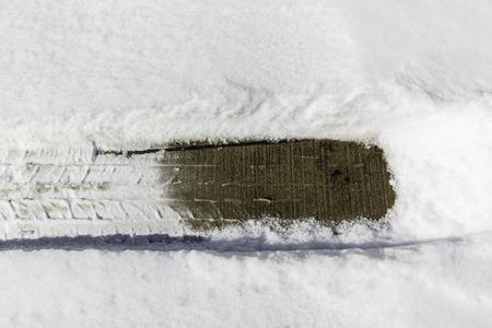 imprint: Car tire imprint in fresh snow