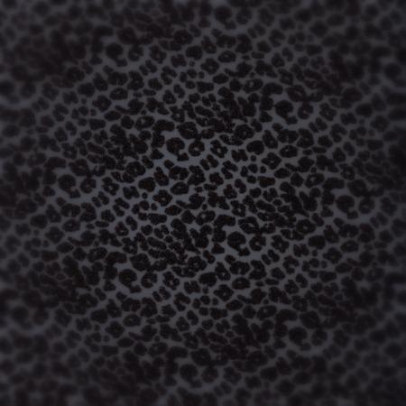 jaguar: Glitter background  with dark jaguar skin pattern and blur corners
