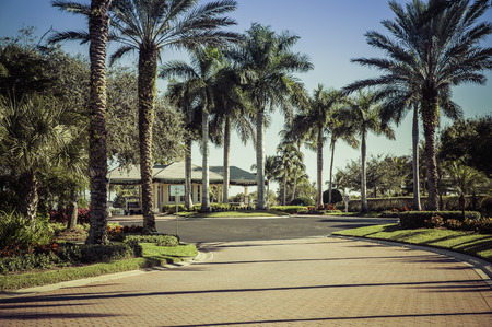 entrance gate: Road to gated community in South Florida