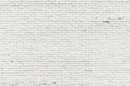 White brick wall for background or texture Reklamní fotografie - 41779457