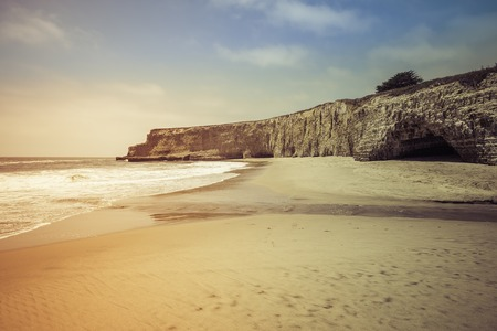 steep cliffs: Empty Beach with steep cliffs - light leak Stock Photo