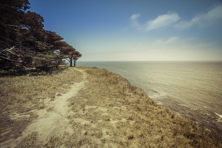 steep cliffs: Empty Beach with steep cliffs - vintage view Stock Photo