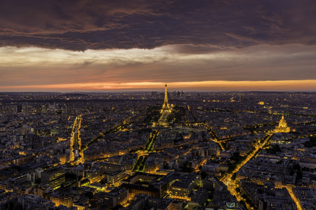 paris france: Aerial view of Paris with Eiffel Tower and scenic clouds at sunset, France. Editorial