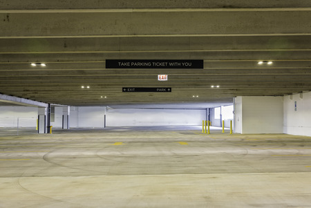 empty warehouse: Empty parking garage with sign