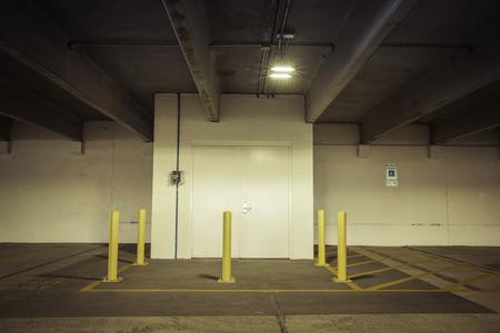 empty warehouse: Empty parking garage metal door Stock Photo