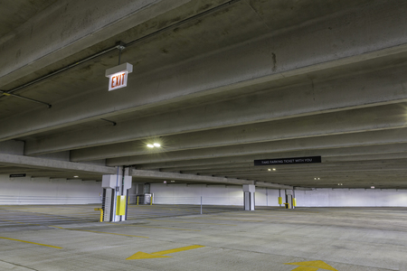 empty warehouse: Empty parking garage with exit sign