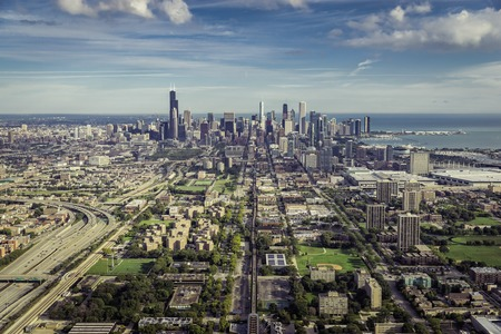 Aerial view through Chicago Downtown with suburbs - high angle