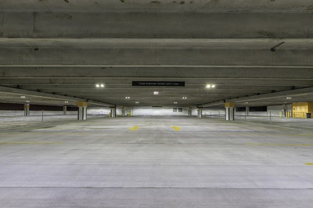 a lot  of: Empty parking garage with sign