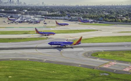jets: Aerial view of Busy Southwest Airport Terminal in Chicago With Jets Editorial