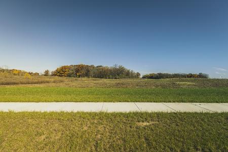 subdivision: Concrete pavement in new real estate subdivision Stock Photo