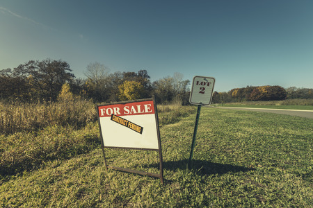 land: Lot for sale sign with vintage colors Stock Photo