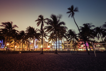 ocean sunset: Ocean Drive street with illuminated buildings, South Beach , Florida