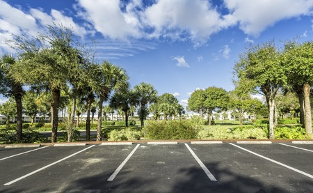 a lot  of: Gated community empty parking lot  in South Florida