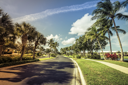 gated: Gated community road and condominiums in South Florida Stock Photo