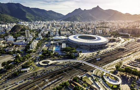RIO DE JANEIRO, BRAZIL - FEBRUARY  2015: Aerial photo of Maracana Stadium with panorama of Rio De Janeiro. Opening and closing of 2016 Olympic Games will be held at Maracana Stadium. Reklamní fotografie - 53206602