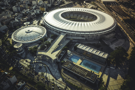 olympic stadium: RIO DE JANEIRO, BRAZIL - FEBRUARY  2015: Aerial photo of Maracana Stadium with panorama of Rio De Janeiro. Opening and closing of 2016 Olympic Games will be held at Maracana Stadium. Editorial