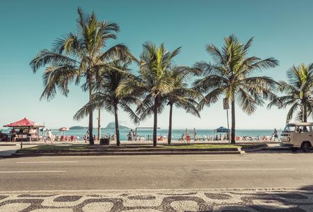 RIO DE JANEIRO, BRAZIL - FEBRUARY  2016: People enjoying the sun on iconic Ipanema Beach in Rio de Janeiro. Rio will host 2016 Summer sports competition Games.