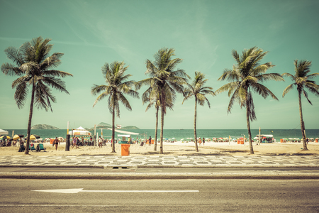 Sunny day with Palms on Ipanema Beach in Rio De Janeiro, Brazil. Vintage colors 에디토리얼