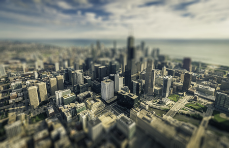 tilt view: Chicago downtown skyscrapers aerial view. Vintage colors with tilt shift effect