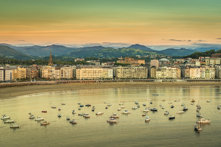 basque country: Old Town and Beach of San Sebastian, sunset light, Spain Stock Photo
