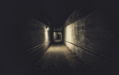 character traits: Empty underpass tunnel at night