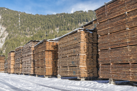 Wood boards at the sawmill in winter