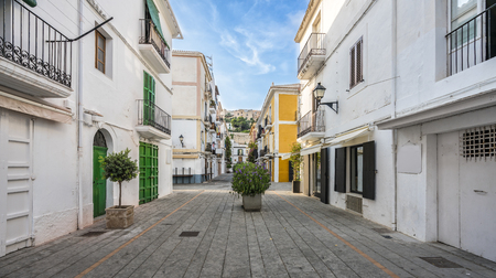 Typical street in old town of Ibiza, Balearic Islands, Spain. Morning light. Wide angle Archivio Fotografico