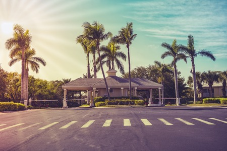 Guard entrance to gated community in South Florida. Light effect applied
