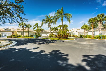 Typical houses with palms in subdivision, South Florida Stock Photo