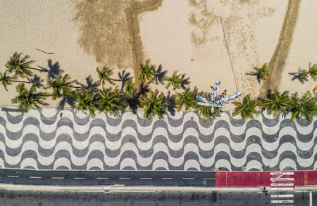 Aerial top view of Copacabana Beach sidewalk with palms, Rio De Janeiro, Brazil Stock Photo