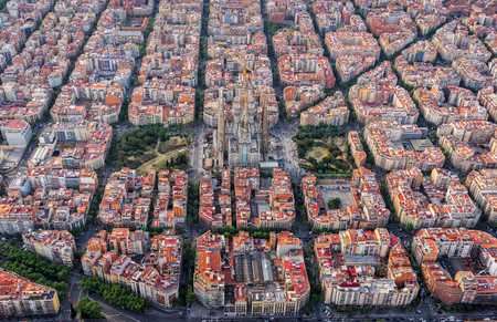 Aerial view of Barcelona Eixample residencial district, typical urban squares, Spain. Late afternoon soft light