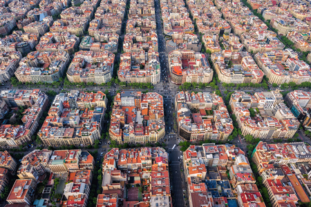 Barcelona aerial top view, Eixample residencial famous urban grid, Spain. Late afternoon light