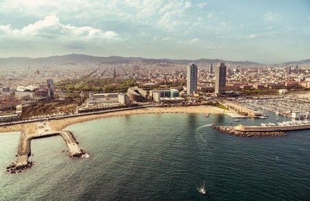 Barcelona skyline aerial view with Port Olimpic and the beach, Spain. Vintage colors