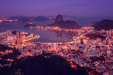 Rio de Janeiro skyline panorama at sunsey, Brazil. Sugarloaf Mountain and Botafogo Bay Editorial