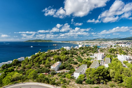 Wide angle view of Eivissa and Playa d'en Bossa Beach , Spain. High angle view with boats on the ocean Stock Photo