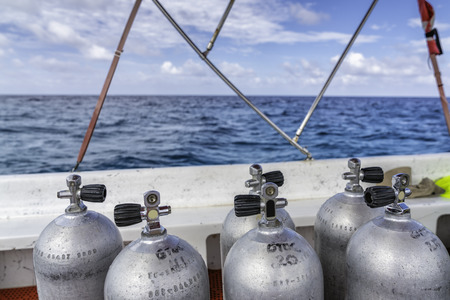 Scuba diving air tanks on the boat, ocean with horizon
