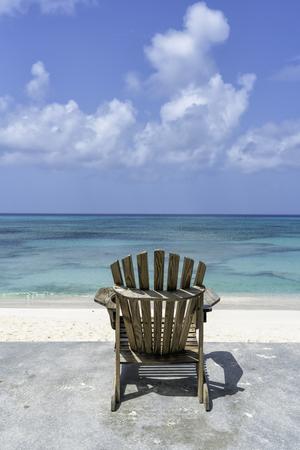 Beach chair in front of tropical ocean Reklamní fotografie