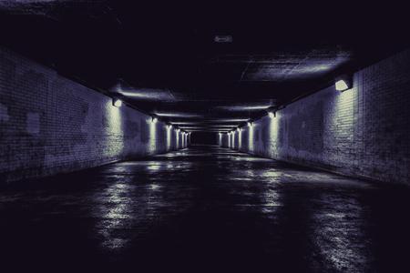 Empty dark tunnel at night with lights Reklamní fotografie