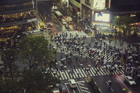 TOKYO, JAPAN - CIRCA APRIL 2017: Busy Scramble crosswalk in Shibuya, Tokyo. High angle view of people crossing the street in business district Redakční