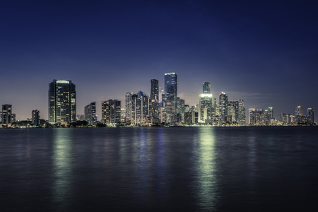 Miami city downtown at night in South Florida. Blue tone