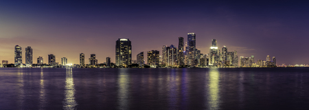 Miami downtown panorama at night, Florida. Reflections in water